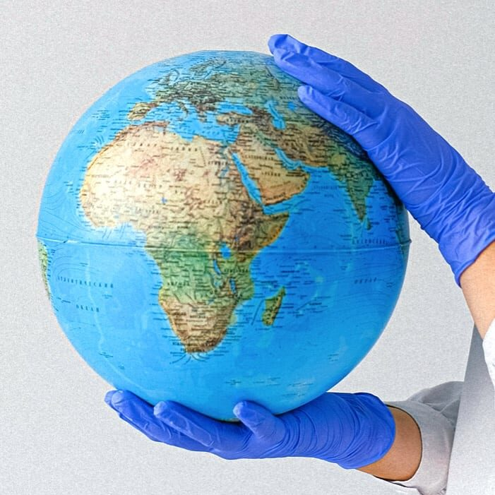 Canva - Person With a Face Mask and Latex Gloves Holding a Globe-2